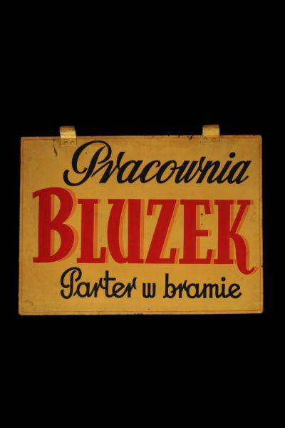 "An Advertising Signboard ""Pracownia Bluzek"""
